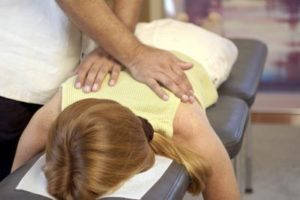 woman on chiro table w/ DC adjust